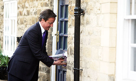 David Cameron hands out leaflets as he campaigns against adoption of AV.