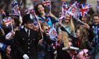 Royal wedding revellers surge along the Mall