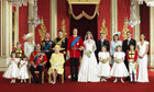 The royal wedding party pose in the Throne Room at Buckingham Palace.