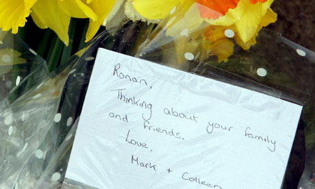 Flowers are left outside the home of Constable Ronan Kerr in Omagh