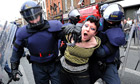 A demonstrator is arrested during a protest in Dublin against the Queen's four-day visit to Ireland