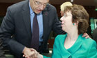 The EU foreign affairs chief, Cathy Ashton, greets French foreign minister Alain Juppe