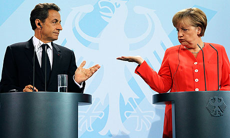 Nicolas Sarkozy and Angela Merkel announce the reformed plans for Greece, in Berlin.