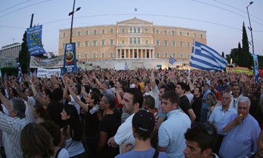 Citizens protest in front of the Greek parliament
