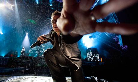 Bono reaches for David Levene's camera