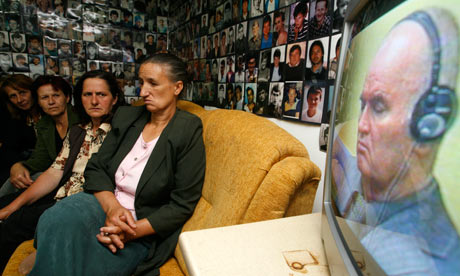 Bosnian Muslim women from Srebrenica watch the broadcast of Ratko Mladic's court proceedings