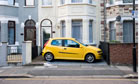 Car parked in front garden of terraced house, London
