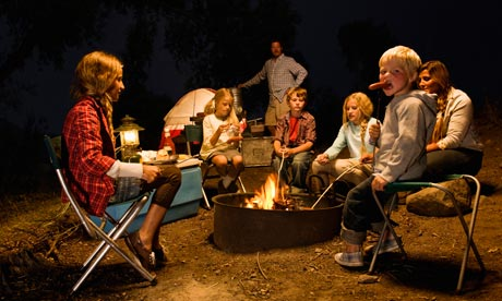 The campfire brings families together, the dinner party drives them apart. Photograph: Darrin Klimek/Getty Images