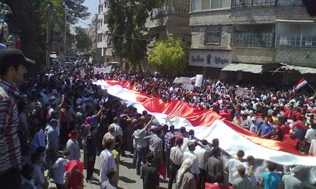 Thousands protest in Hama (Photo courtesy of The Guardian).