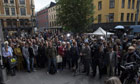 Norway attacks: people gather for vigil in Oslo