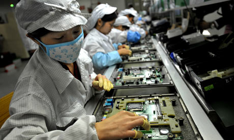 Chinese employees working in a manufacturing plant