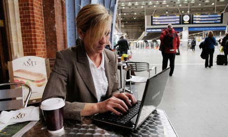 A businesswoman uses a netbook
