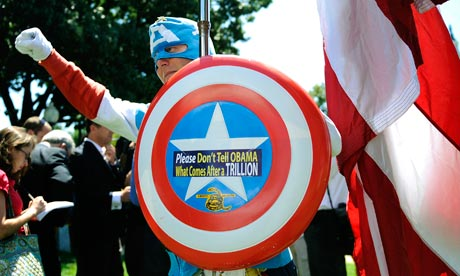 A man dressed as Captain America poses at Tea Party demonstration