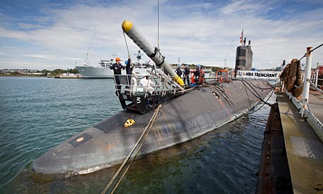 The Royal Navy submarine HMS Trenchant weapon-loading at the Devonport naval base.