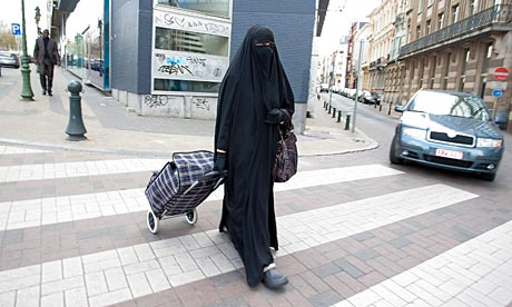 A Muslim woman wearing a niqab in Brussels - under the new Italian law this would be illegal.