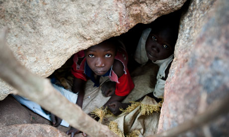 Children take cover in caves in the hills above Kauda in the Nuba mountains, following repeated aerial bombardment of their towns by Sudanese armed forces. Photograph: Phil Moore