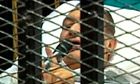 Hosni Mubarak speaks into microphone at his trial