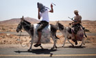 Libyan rebels ride donkeys to reach their comrades