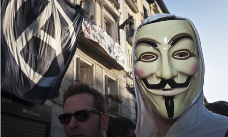 An Anonymous protester in Madrid earlier this month