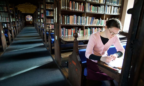 A student studies in her college library