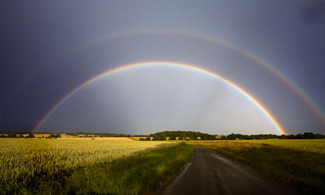 A double rainbow over fields of crops in Hoxne, Suffolk
