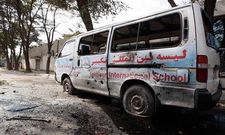 A damaged vehicle after a rocket-propelled attack in Kabul, Afghanistan