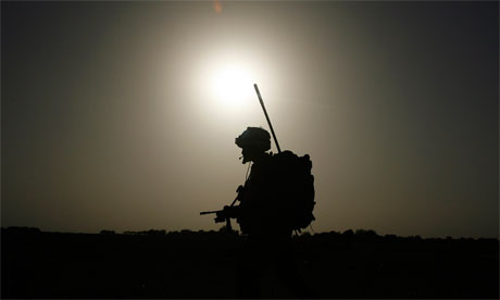 A British soldier on patrol in Helmand province, Afghanistan.