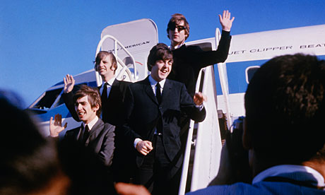 The Beatkles wave to fans at San Francisco airport, in 1964.