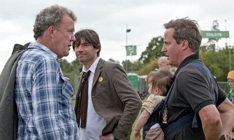 Alex James looks on as Jeremy Clarkson talks to David Cameron