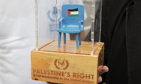 A member of the Palestinian delgation holds a symbolic seat outside the United Nations in New York.