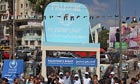 Demonstrators in Ramallah carry a symbolic seat for in support of the Palestinian bid at the UN.