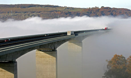 Drivers speed on despite more than half of Hungary's Koroshegy bridge being blanketed in fog.