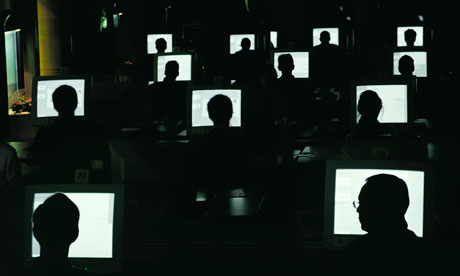 People working at computers in the dark