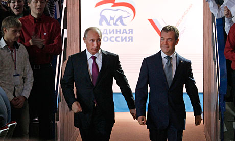 Dmitry Medvedev (r) and Vladimir Putin at the United Russia party congress in Moscow.