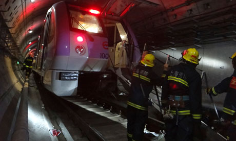 Firemen in Shanghai rescue injured subway passengers