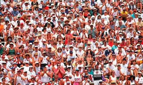 A crowd watching a sporting event