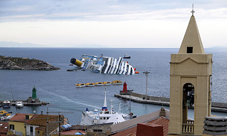 The Costa Concordia lies in the harbour of Giglio as rescue efforts continue.