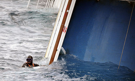 A rescue diver surfaces next to the Costa Concordia in Giglio harbour.