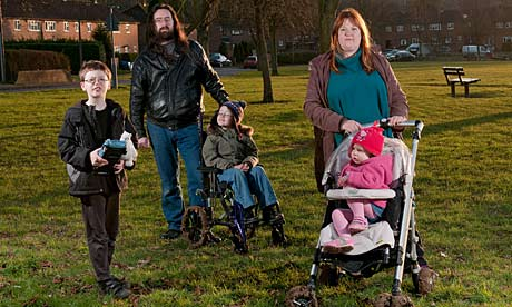 Emma and Chris Ford, with their disabled children, Martyn (7), Rhys (6) and Caitlin (3