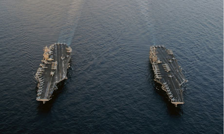 US aircraft carriers patrol near the Strait of Hormuz.