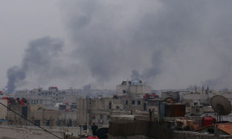 Smoke rises from the suburb of Erbeen in Damascus