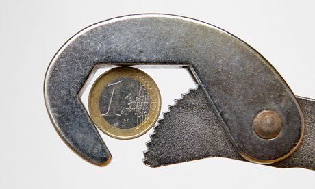 euro coin being held in a wrench