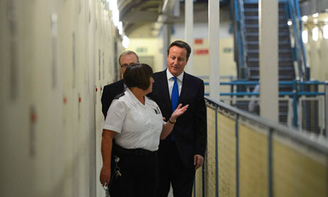 David Cameron is escorted around C wing of Wormwood Scrubs prison