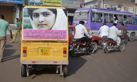 An auto-rickshaw with the image of Malala Yousufzai in Lahore.