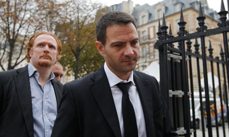 Kerviel arrives with one of his lawyers at the Paris court for the verdict in his appeal trial.