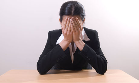 Businesswoman crying at her desk