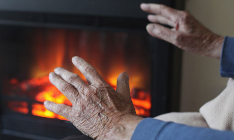 Elderly person sitting by a fire