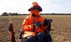 Human scarecrow Jamie Fox, playing a ukelele during a break.