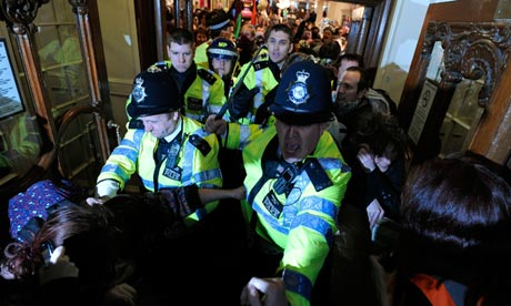 Police officers try to stop protesters o