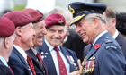 Prince Charles speaks to veterans at the War Memorial museum in Auckland, New Zealand